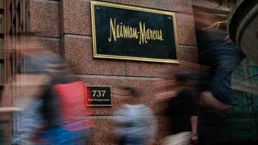 Pedestrians walk past a Neiman Marcus store on the Magnificent Mile in Chicago.