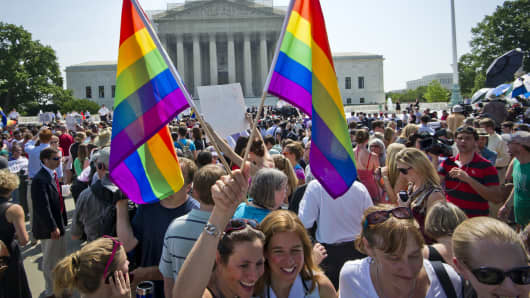 Hundreds of people gather outside the US Supreme Court building in Washington, DC on June 26, 2013 in anticipation of the ruling on California's Proposition 8, the controversial ballot initiative that defines marriage as between a man and a woman.