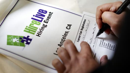 An job seeker fills out a career fair information sheet before interviewing with company representatives at the Hire Live Job Fair in El Segundo, California, U.S.