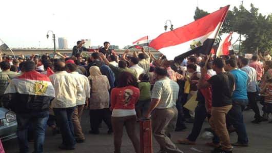 Anti-government protesters on their way to Tahrir Square on Sunday.