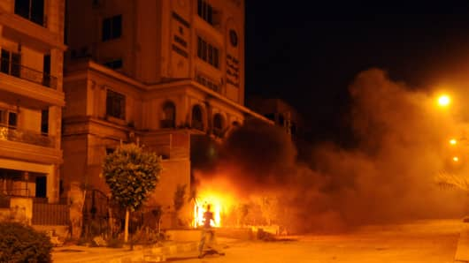 Egyptians opposed to President Mohamed Morsi set fire to the Muslim Brotherhood headquarters in the Moqattam district during clashes in Cairo on June 30, 2013.