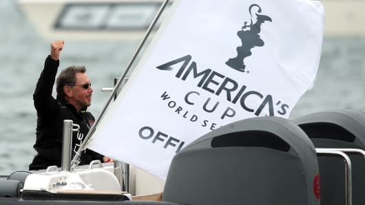 Larry Ellison celebrates after Oracle Team USA  won a semifinal match race during the America's Cup World Series last August in San Francisco.