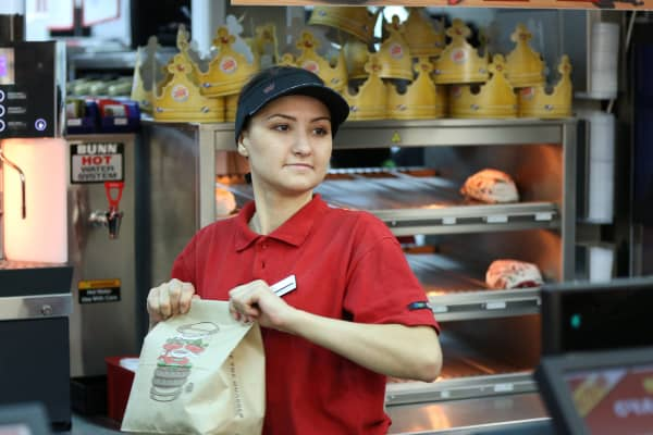 An employee prepares a bag containing a customer's food order inside a Burger King fast food restaurant in Moscow, Russia.