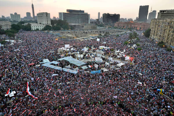 Hundreds of thousands of Egyptian demonstrators gather in Cairo's landmark Tahrir square during a protest calling for the ouster of President Mohamed Morsi on July 1, 2013. Egypt's armed forces warned that it will intervene if the people's demands are not met within 48 hours, after millions took to the streets to demand the resignation of Morsi