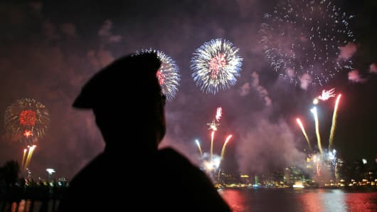 A New York City police officer at the 4th of July fireworks.