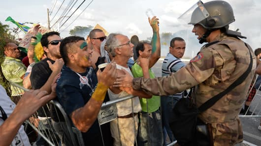 Demonstrators argue with police during a protest near Mineirão stadium in Belo Horizonte.