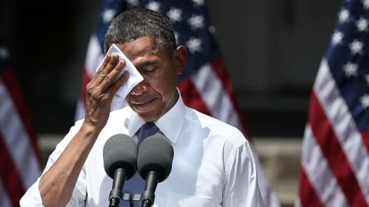 President Barack Obama feels the heat as he unveils his plan on climate change June 25 at Georgetown University in Washington.