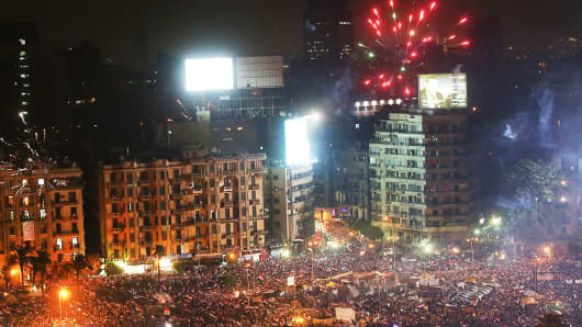 Fireworks emanate from Tahrir Square after a broadcast by the head of the Egyptian military confirming that they will temporarily be taking over from the country's first democratically elected president Mohammed Morsi on July 3, 2013 in Cairo, Egypt.