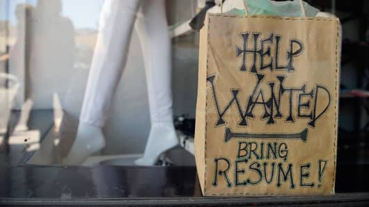 A help wanted sign is placed in the window of Veronica M clothing store in Pasadena, California.