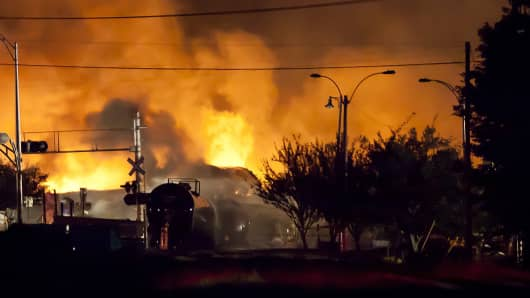 Firefighters battle blazes after a freight train loaded with oil derailed in Lac-Megantic, Quebec, on July 6, 2013.