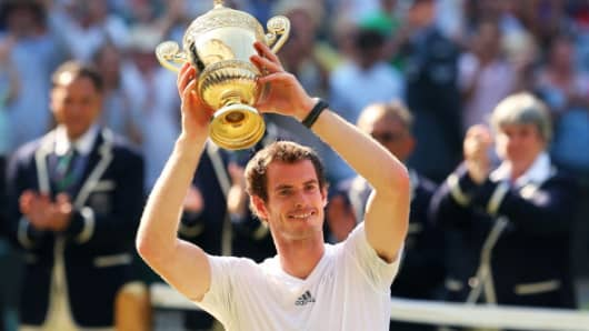 Andy Murray poses with the Gentlemen's Singles Trophy at the Wimbledon Lawn Tennis Championships on July 7, 2013.