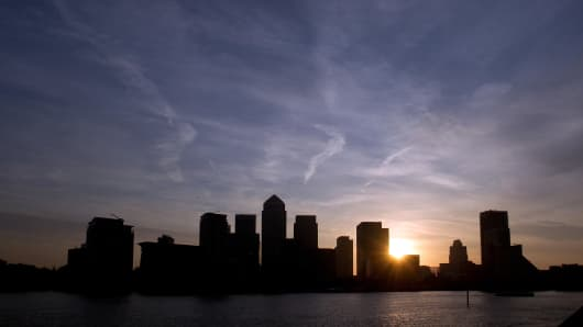 The sun rises over skyscrapers in the Canary Wharf business district in London, U.K.