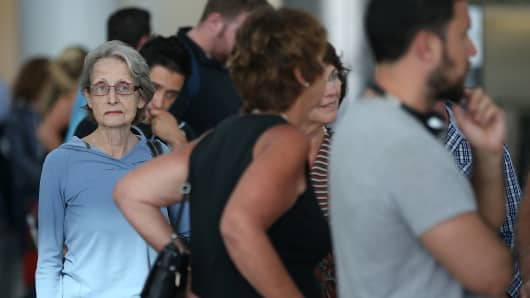 Passengers line up to check in at San Francisco International on July 6, after the crash of Asiana Flight 214.