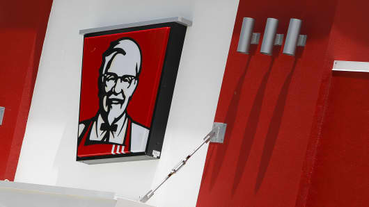 The KFC logo is displayed outside on a KFC restaurant, a unit of Yum! Brands Inc., in Houston, Texas.