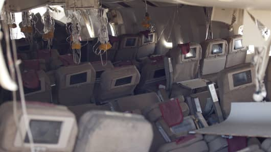 Oxygen masks hang from the ceiling in the cabin interior of Asiana Airlines Flight 214.