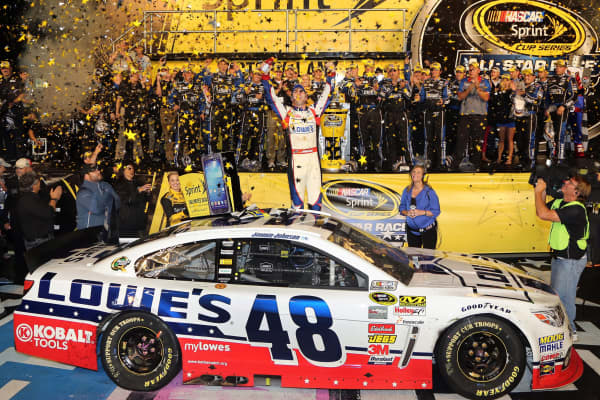Jimmie Johnson celebrates after winning the NASCAR Sprint Cup Series All-Star Race at Charlotte Motor Speedway.