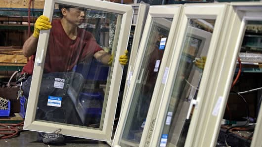 A worker assembles window frames at Crystal Windows & Doors IL Manufacturer in Chicago, Illinois.