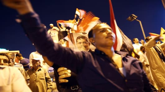 Supporters of ousted president Mohamed Morsi demonstrate in the street earlier this month.