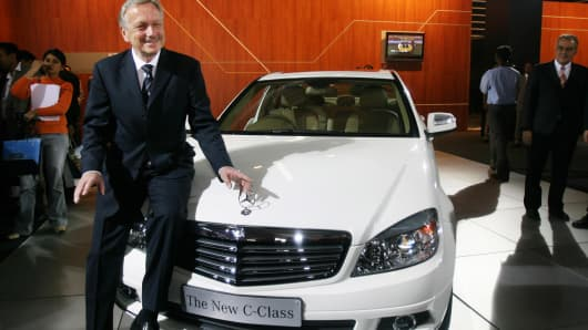 Mercedes' Joachim Schmidt poses with a C-Class car in January 2008.