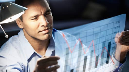 Premium: Man looking at graph investor