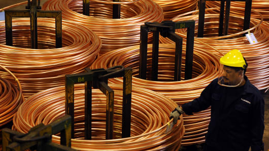 An employee inspects a coil of copper rod at the Luvata Malaysia Bhd. plant in Pasir Gudang, Johor, Malaysia.