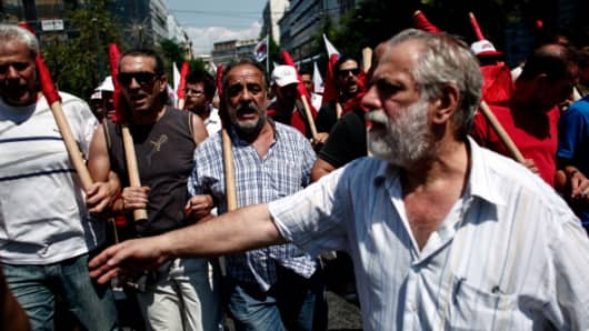 Greek communist union members protest on July 16