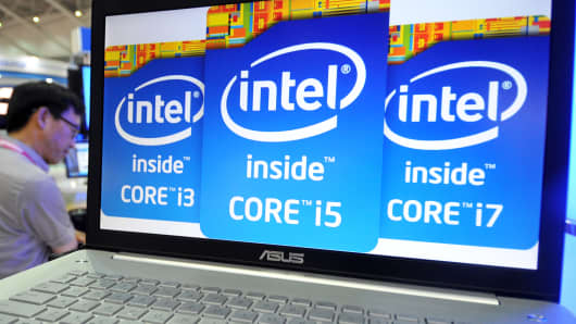 A visitor walks past a notebook showing the Intel logos during the 2013 Computex in Taipei on June 4, 2013.