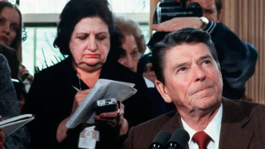U.S. President Ronald Reagan greets the press, including Helen Thomas (L), in the Oval Office during a press conference in the White House in Washington, DC.
