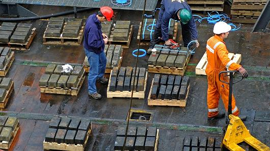 65 tons of silver recently discovered from a shipwreck is counted by crewman.