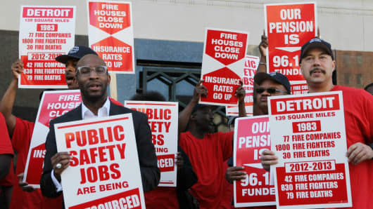 Protesters stand outside the Theodore Levin United States court house in opposition to the city of Detroit filing for bankruptcy.