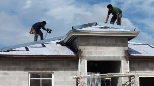 Construction workers build a new home in Miami, Florida.