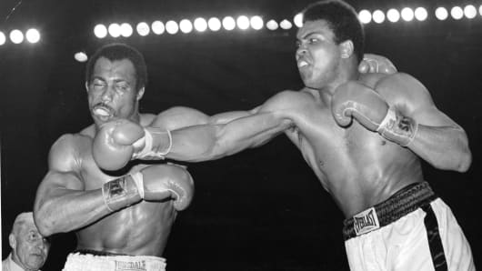 Muhammad Ali (R) connects a right punch against Ken Norton during the fight at the Sports Arena on March 31,1973 in San Diego, California.