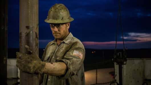 A derrick hand for Raven Drilling, works on an oil rig drilling into the Bakken shale formation outside Watford City, N.D.