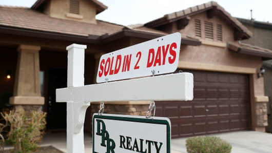 A sold sign is posted in front of a home in Phoenix, Arizona.