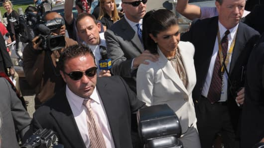 Joe Giudice and Teresa Giudice appear in court to face charges of defrauding lenders, illegally obtaining mortgages and other loans as well as allegedly hiding assets and income during a bankruptcy case on July 30, 2013 in Newark, N.J.