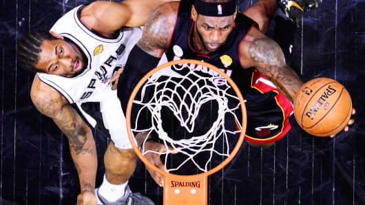 LeBron James No. 6 of the Miami Heat goes up for a shot against Kawhi Leonard No. 2 of the San Antonio Spurs during Game 4 of the 2013 NBA Finals.