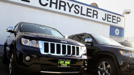 Jeep Grand Cherokees are displayed for sale at Buerge Chrysler Jeep dealership in Los Angeles, California.