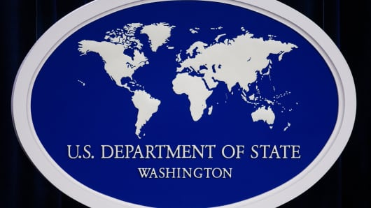 The US Department of State logo.