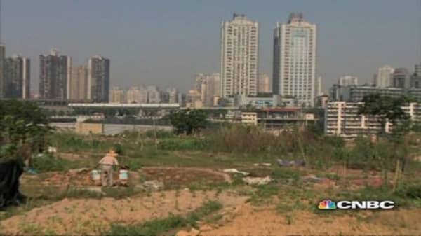 China's farmers trade acres for apartments