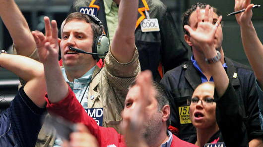 Traders at the CME Group's Chicago Board of Trade