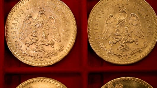 Mexican 50-peso gold pieces that belonged to Walter Samaszko Jr., who died in June 2012. They were set to be auctioned in Carson City, Nev.