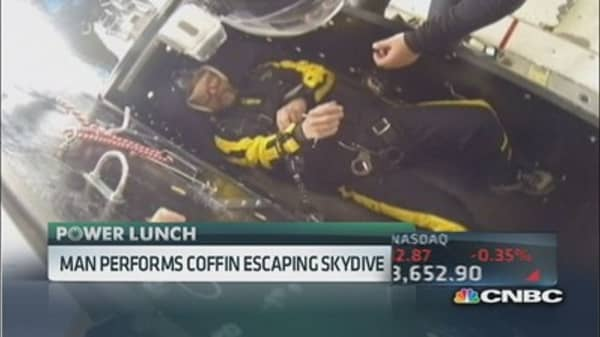 Man performs coffin-escaping skydive