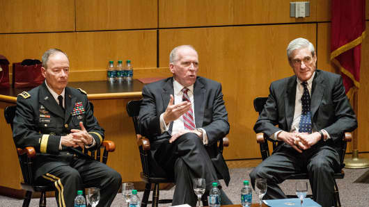 General Keith B. Alexander, Director of the National Security Agency (NSA) and Commander of U.S. Cyber Command (L); John O. Brennan, Director of the Central Intelligence Agency (CIA) (C); and Robert S. Mueller III, Director of the Federal Bureau of Investigation (FBI) (R).
