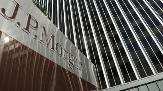 A JPMorgan sign is seen outside the Los Angeles office tower housing the financial services firm's offices.