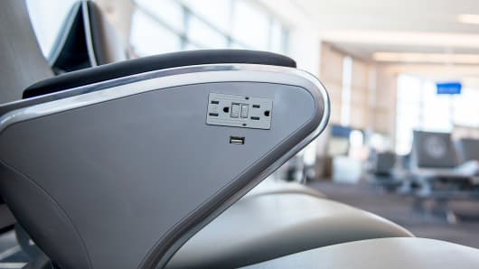 New seats with USB ports, power outlets and cup holders at the San Diego International Airport.