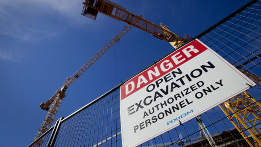 A 'Danger' sign is displayed at a condominium construction site in downtown Vancouver, British Columbia, Canada.