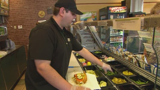 Luke Perfect, who works at a Subway franchise in Kennebunk, Maine, expects to have his hours cut because his employer says offering him health insurance under Obamacare's employer mandate is too expensive.