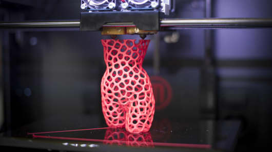 3-D printer creates a sculpture of a woman at the DMY International Design Festival at the former Tempelhof Airport Hangar on June 5, 2013 in Berlin, Germany.