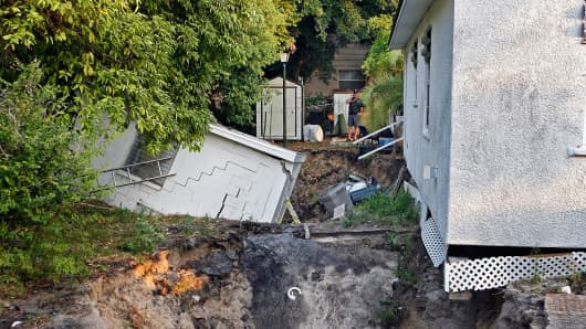 Two sinkholes in the backyard of a house in Tarpon Springs, Fla., on June 16, 2011.