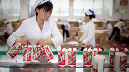 Workers  package baijiu liquor in China.
